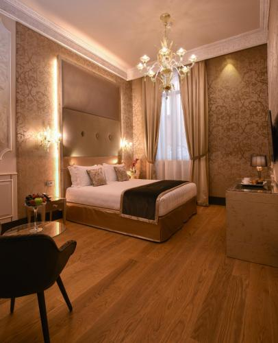 A bed or beds in a room at Santa Croce Boutique Hotel