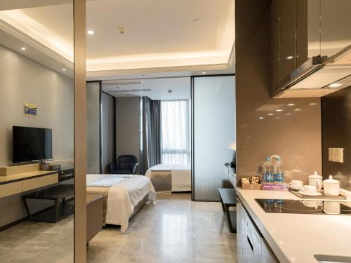 A television and/or entertainment center at Pengman Beijing Rd. A-mall Apartment