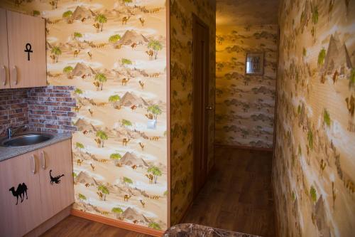 Кухня или мини-кухня в Apartment on Moskovskaya 4A