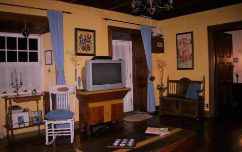 A television and/or entertainment center at Quinta da Ana