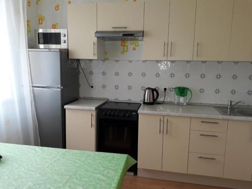 Una cocina o zona de cocina en Дмитров посуточно