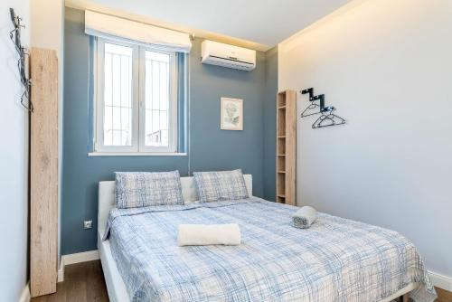 Ein Bett oder Betten in einem Zimmer der Unterkunft Top of the city Apartment