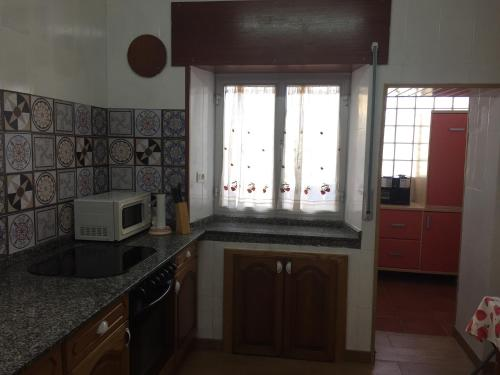 A kitchen or kitchenette at Vivienda Vacacional Puerto De Tapia