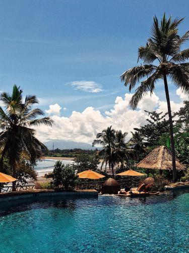 The swimming pool at or near Puri Dajuma Beach Eco-Resort & Spa