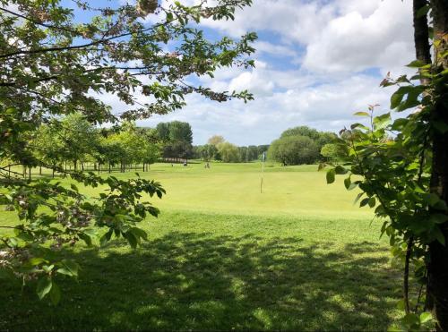 A garden outside Malkins Bank Golf Club