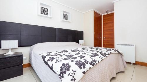 Cama o camas de una habitación en Carmelitas Contemporary