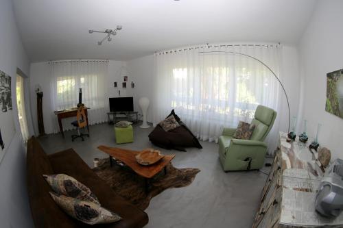 Ein Sitzbereich in der Unterkunft Avantgarde Living