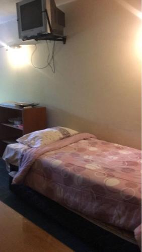 Una cama o camas en una habitación de Solar II