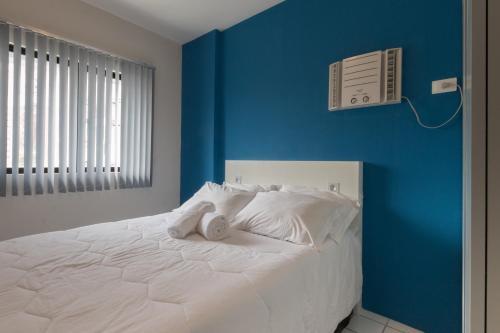 A bed or beds in a room at PIP201 Agradável flat em Boa Viagem, até 4 pessoas