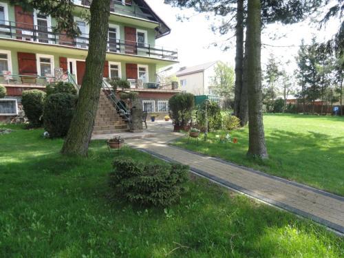 Сад в Villa Wodnik nad jeziorem