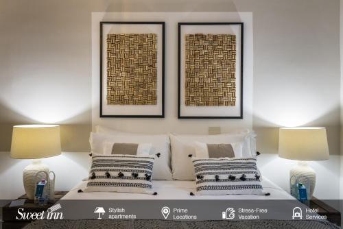 A bed or beds in a room at Sweet Inn - Fienaroli