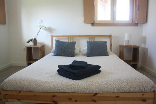 Llit o llits en una habitació de Casa Moderna Proxima da Praia