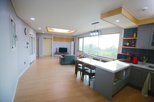 A kitchen or kitchenette at Seong Ge Dol Pension