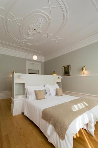 A bed or beds in a room at Original Douro Hotel