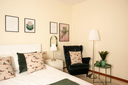 A bed or beds in a room at Lalaland Apartment