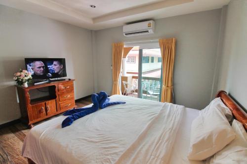 Кровать или кровати в номере Jomtien Beach Pool House