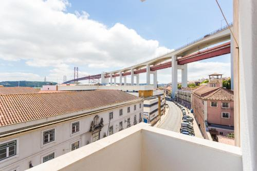 A balcony or terrace at Le Flat | Alcântara River View