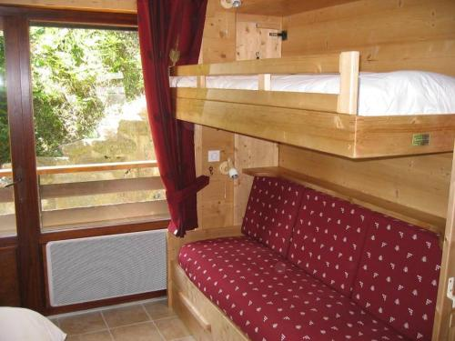 A bunk bed or bunk beds in a room at Résidence Tournette