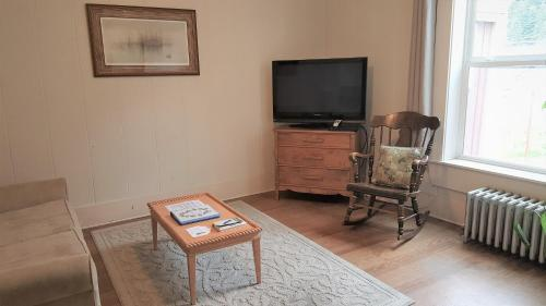 A television and/or entertainment center at Coastal Heritage Accommodations