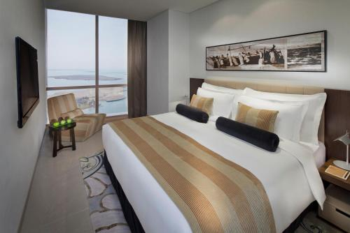 A bed or beds in a room at Jumeirah at Etihad Towers Residence