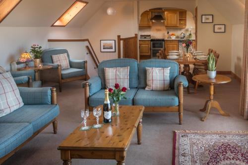 A seating area at Carden Holiday Cottages