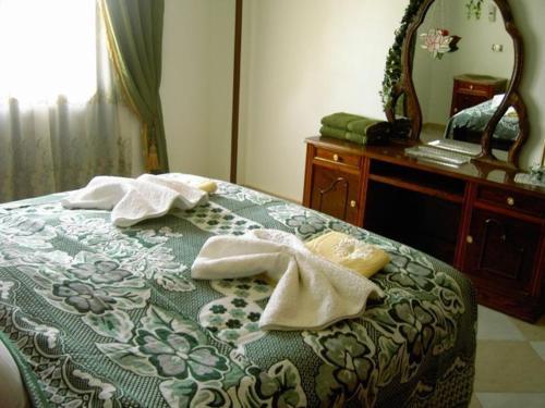 Ein Bett oder Betten in einem Zimmer der Unterkunft Nile Dream Apartments House