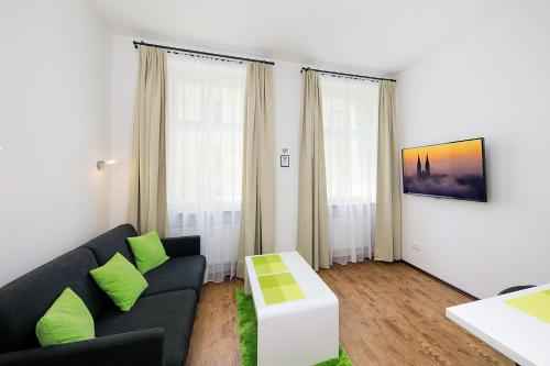 A seating area at Letna luxury apartment