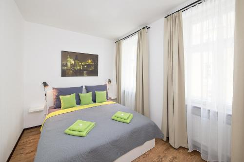 A bed or beds in a room at Letna luxury apartment