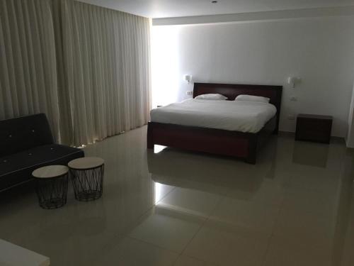 מיטה או מיטות בחדר ב-דירות כרמל