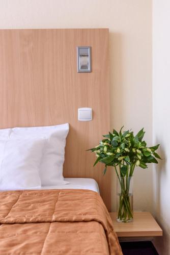 Кровать или кровати в номере Отель Раушен
