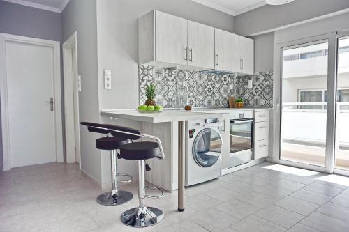 مطبخ أو مطبخ صغير في Alkyoni City Apartment