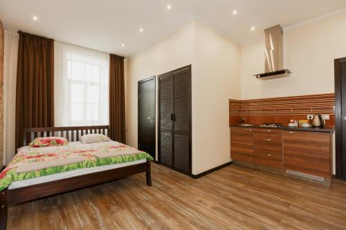 A bed or beds in a room at ApartHotel Riga