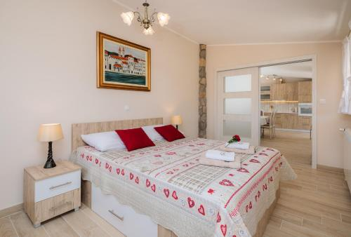 Postel nebo postele na pokoji v ubytování Apartmani Oaza