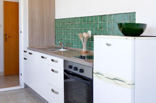 Una cocina o zona de cocina en Apartments Mel