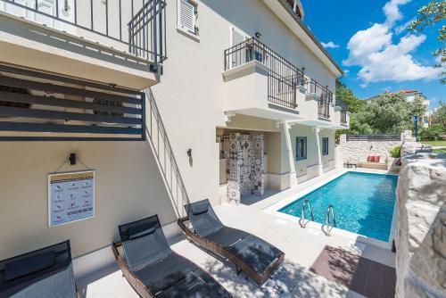 The swimming pool at or close to Apartments SKODA I , SKODA II