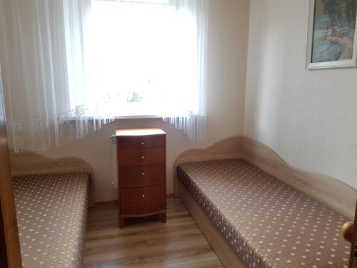 Lova arba lovos apgyvendinimo įstaigoje Agnės apartamentas