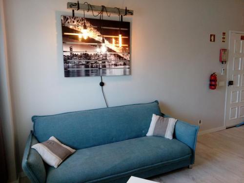 Uma área de estar em Apartamento Ocean Dreams