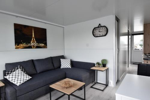 """A seating area at Cosy floating boatlodge, """"Paris"""""""