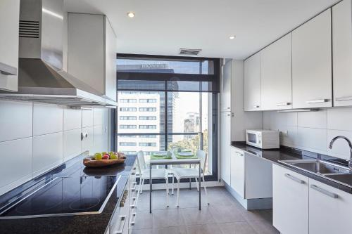 A kitchen or kitchenette at The Lonely Chimney Apartments