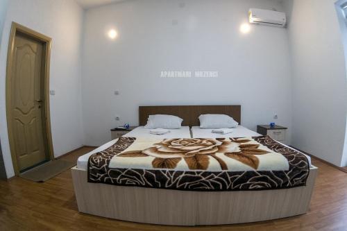 Krevet ili kreveti u jedinici u okviru objekta Mrzenci Apartments