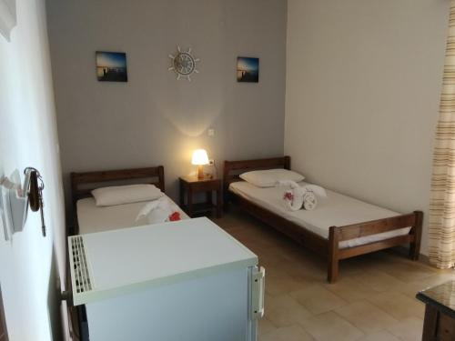 A bed or beds in a room at Rooms Leonidas