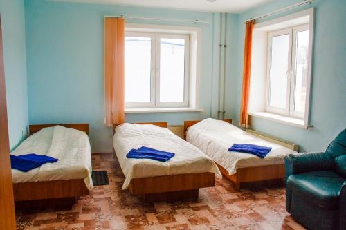 A bed or beds in a room at Байкальская гавань