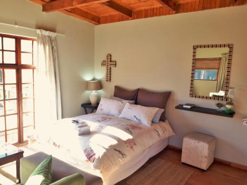 A bed or beds in a room at Swallows Nest Self Catering Chalet