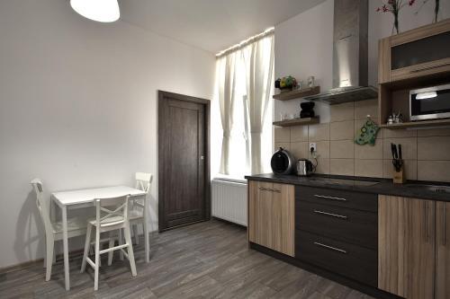A kitchen or kitchenette at TopApartmany Lesni