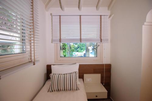 Säng eller sängar i ett rum på Pansion Nina