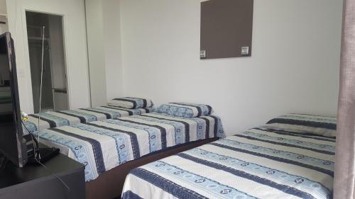 En eller flere senge i et værelse på Unlimited Ocean Front
