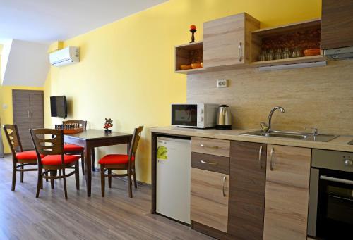 מטבח או מטבחון ב-Visito Aparthouse