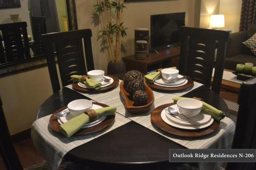 A restaurant or other place to eat at Outlook Ridge Residences N-206