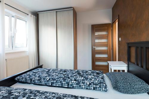 Posteľ alebo postele v izbe v ubytovaní Rooftop apartment I.