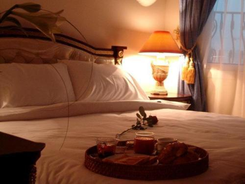 A bed or beds in a room at Al Sadd Suites Hotel